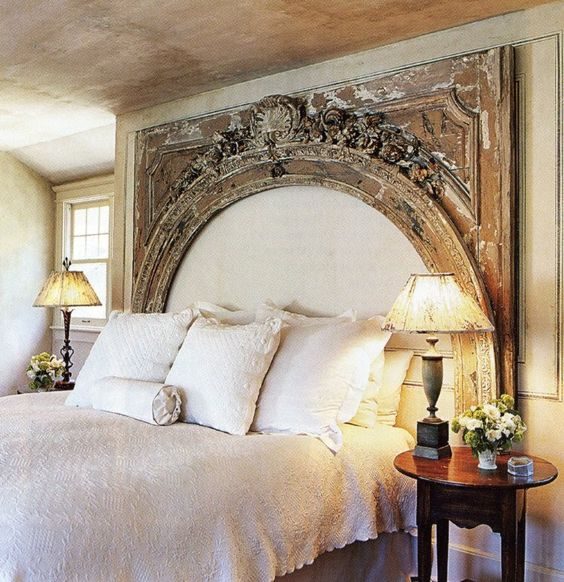 a refined vintage bedroom with a vintage shabby chic wooden frame   a part of an old gate that wows