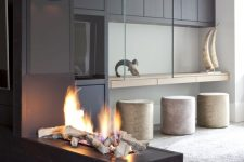 a black tile and glass fireplace – an ethanol one with faux wood looks very spectacular and very bold