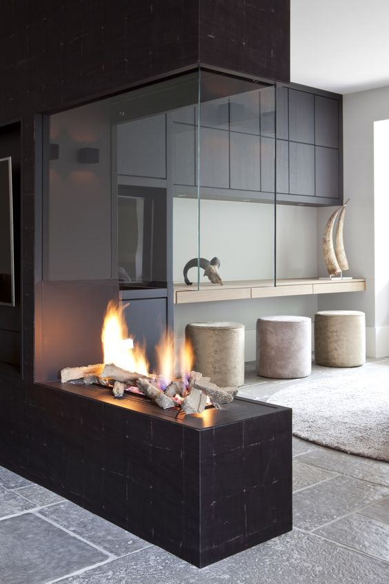 a black tile and glass fireplace - an ethanol one with faux wood looks very spectacular and very bold