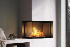 a contemporary built-in fireplace in neutrals with a glass cover and a firewood storage space is a stylish decoration