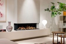 a contemporary built-in fireplace in white, with a glass cover is a stylish and cozy decoration that will add style