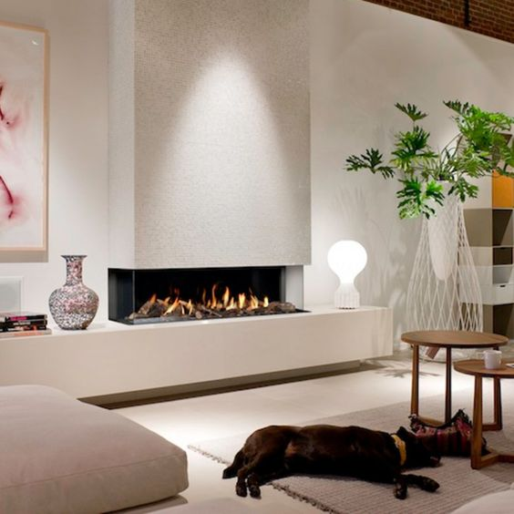 a contemporary built in fireplace in white, with a glass cover is a stylish and cozy decoration that will add style