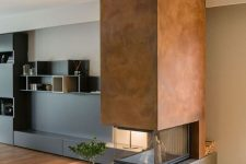 concrete fireplace that looks quite contemporary