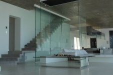 a contemporary to minimalist fireplace with a metal base, a white hood with a glass cover looks spectacular