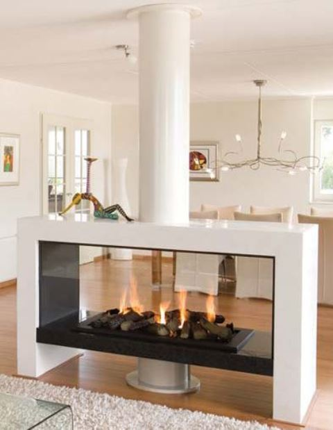 a contemporary white fireplace with a glass cover, an enthanol fireplace with faux firewood is a very cozy piece to rock