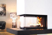 a contrasting minimalist fireplace in black, white and with a glass cover is a cozy and chic piece to make a statement