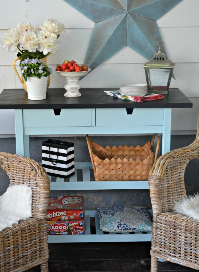 a cool IKEA Forhoja cart makeover with blue and black paint makes it bolder and highlights the farmhouse feel