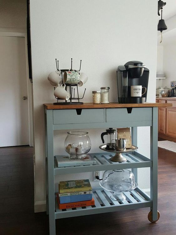a cool coffee station made of a Forhoja cart painted blue and with a stained wooden countertop is a stylish rustic option
