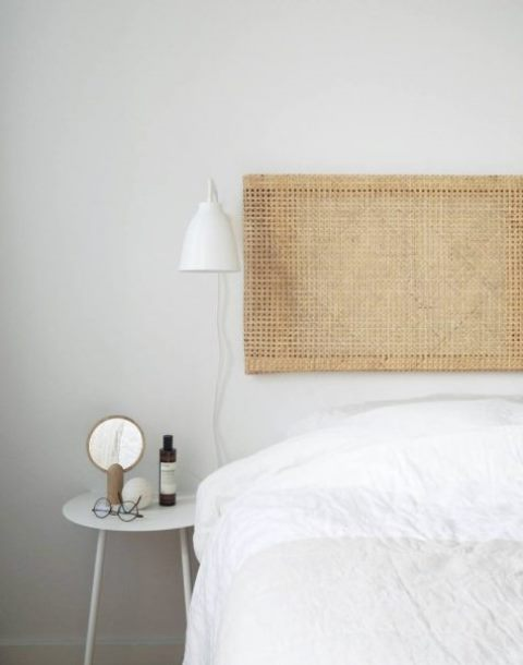 a cool rattan headboard made of a frame of an Ivar side unit and cane webbing is a very fresh ide for a bedroom