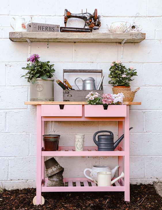 a gardening station of an IKEA Forhoja cart with pink paint and a light stained countertop is super cute