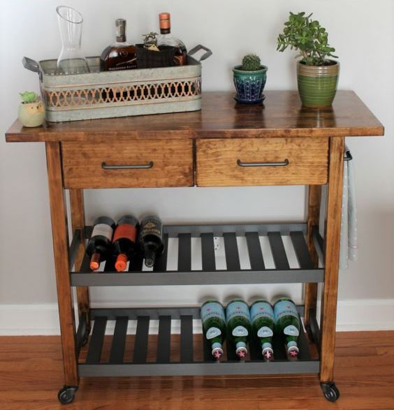 a mid-century modern IKEA Forhoja cart hack with dark stain, a butcherblock countertop and dark shelves as a drink cart