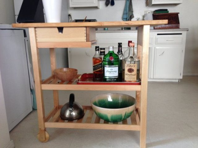 a mini bar made of an IKEA Forhoja cart is a cool rustic idea for your home and a nice use of your space