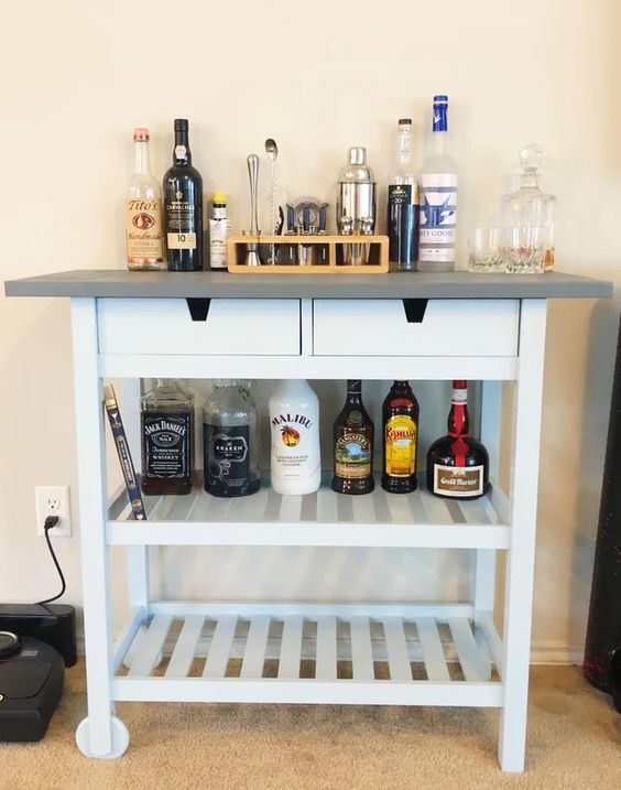 a stylish IKEA Forhoja bar cart hack with a sleek grey countertop and drawers is an ultimate modern farmhouse option