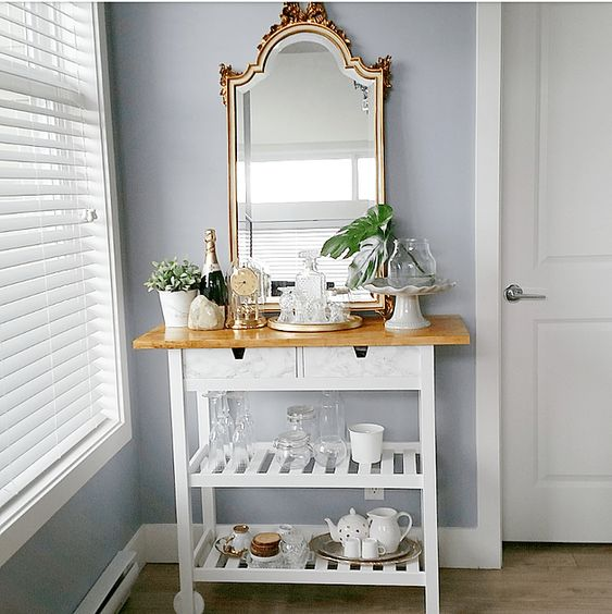 a stylish IKEA Forhoja cart hack with white paint, a light-stained countertop and drawers finished with marble contact paper