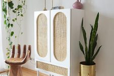 a stylish IKEA Ivar hack done with cane webbing is a cool piece for a modern space and it brings a whimsy touch