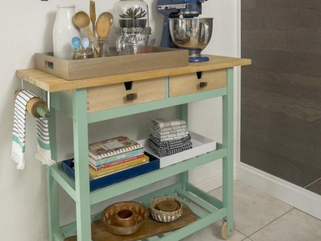 a stylish cooking station of an IKEA Forhoja cart hacked with mint paint and a butcherblock countertop is a stylish modenr farmhouse piece