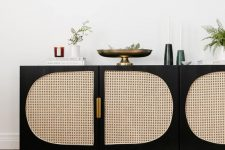 an IKEA Besta TV unit done very contrasting, in black and with can webbing plus gold handles is a bold idea