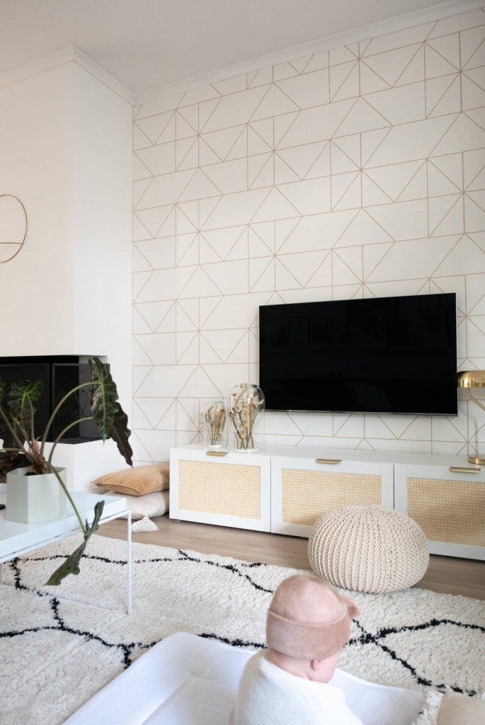 an IKEA Besta TV unit hacked with new handles and cane webbing is very stylish and a bit boho