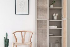 an IKEA Billy bookcase hack with new doors and cane webbing is super stylish and elegant