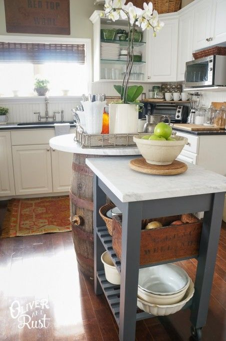 an IKEA Forhoja cart cut in half and painted graphite grey, with a white marble countertop is a nice and stylish kitchen island