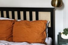 an IKEA Hemnes bed hacked with cane webbing looks super chic and bold and adds contrast to the space