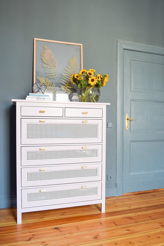 an IKEA Hemnes dresser hack done with blush paint, cane webbing and chic handles is cool for a modern space