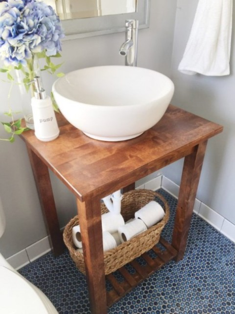 an Ikea Bekvam cart turned into a stylish vanity in rustic style won't take much space, which is ideal for a small bathroom