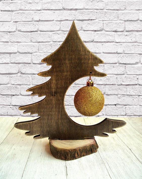 a mini tabletop Christmas tree of plywood on a wood slice - just hang a single ornament and voila