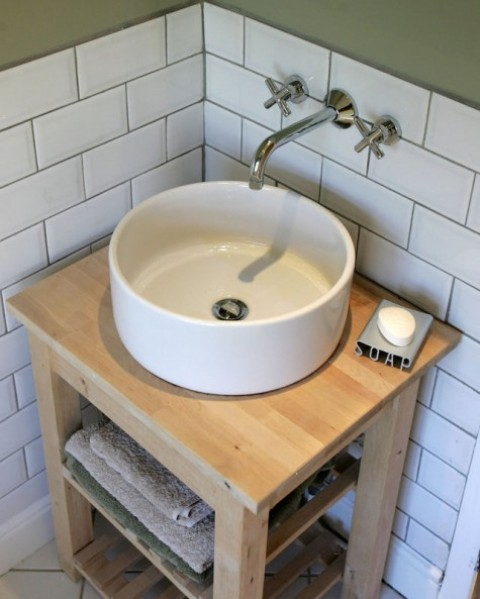 an Ikea Bekvam kitchen cart and Tornviken countertop sink turned into a chic rustic vanity in modern farmhouse style