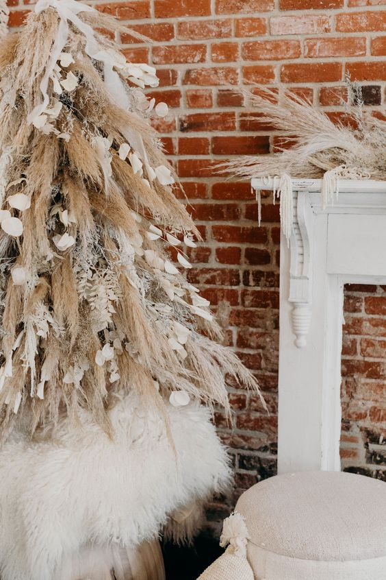 a creative boho Christmas tree of pampas grass and snowy branches, petals and ribbons and matching mantel decor