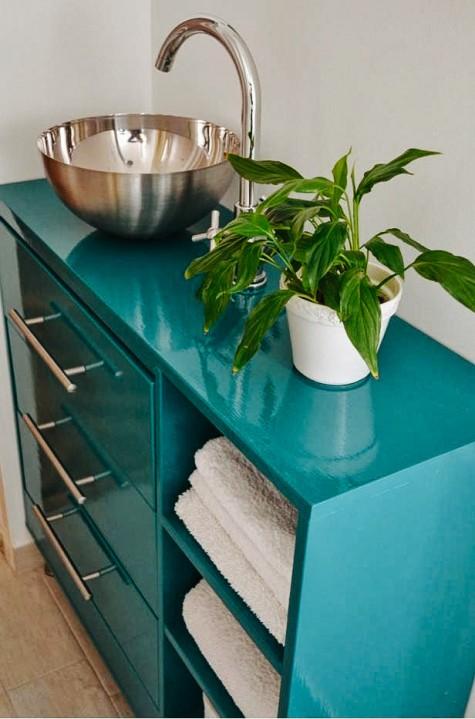 a bold bathroom vanity plus a sink made of an Ikea Rast 3-drawer chest, a Blanda blank serving bowl, a Dalksar faucet
