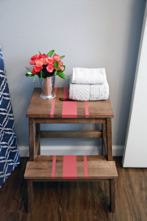 a convenient tub-side storage unit of an Ikea Bekvam stool - use it for towels, soaps and much more