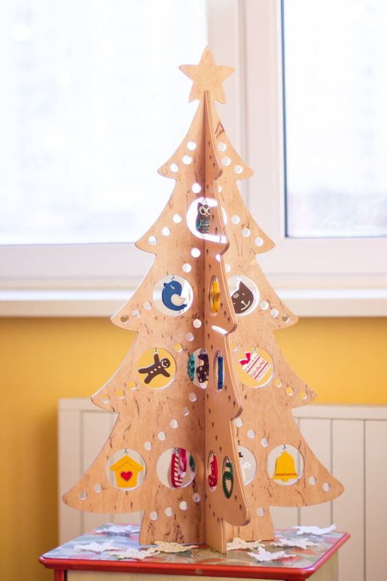 a 3D plywood Christmas tree with perforation and cutouts for hanging ornaments is a very cool idea for a tabletop tree