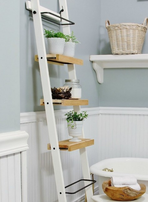 a space-saving storage unit made of Ikea towel holders and some wooden planks is a timeless idea for any small bathroom