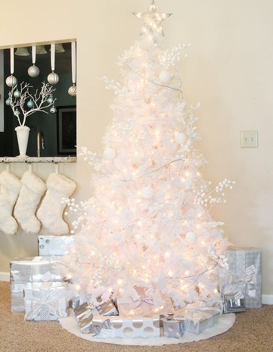 a lovely white Christmas tree with lights, berries and white ornaments plus a light star topper is a gorgeous idea to try