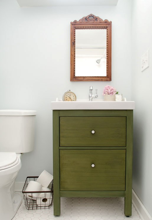an IKEA vanity redone in grassy green to make it look bold, chic and cool and to add color to this vintage inspired space