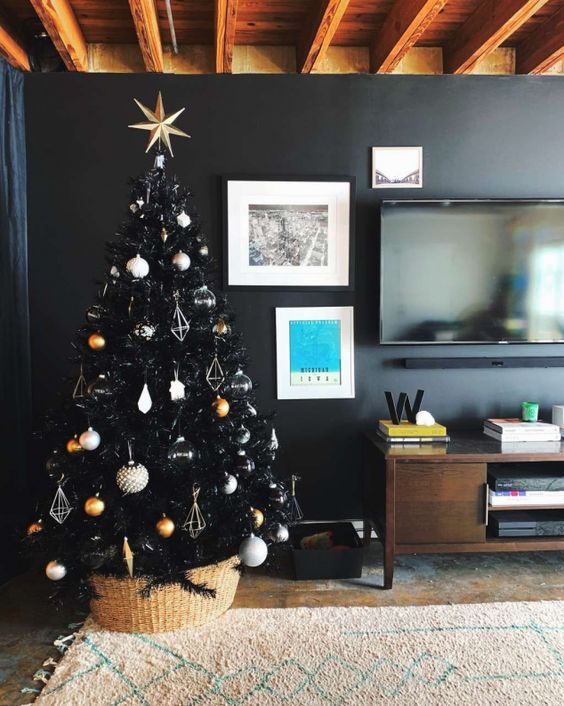 a chic black Christmas tree with white, copper, gold and silver ornaments and himmeli ones looks ultra-modern