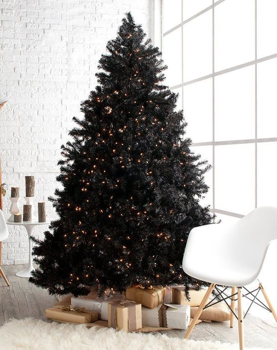 a pre-lit black Christmas tree with piles of gifts is a lovely and bold idea for a modern space - who needs decor when you have lights
