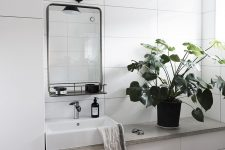 12 built-in cabinets and a vanity in a bathroom made using IKEA white cabinet fronts – a genius and easy idea for a minimalist bathroom