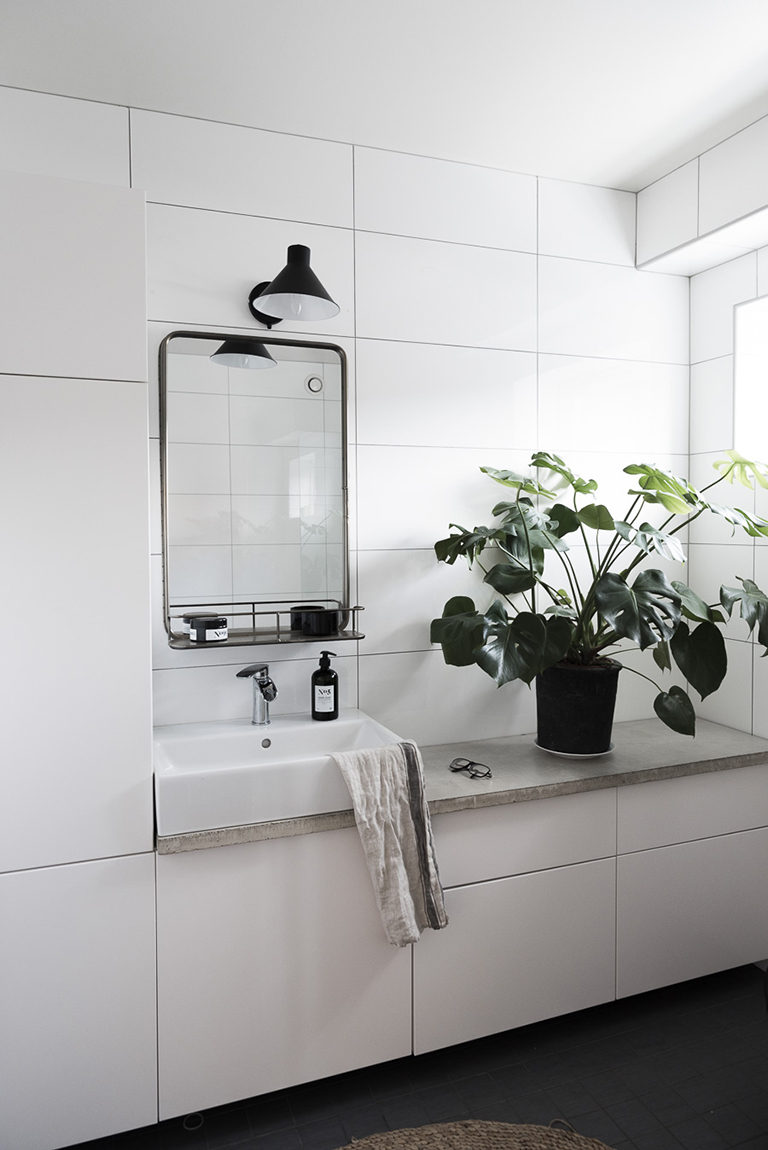 built-in cabinets and a vanity in a bathroom made using IKEA white cabinet fronts - a genius and easy idea for a minimalist bathroom