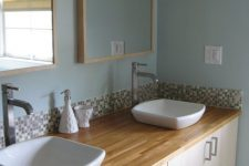 13 IKEA kitchen cabinets used to create a comfortable double vanity with stylish sinks, great and very easy to rock