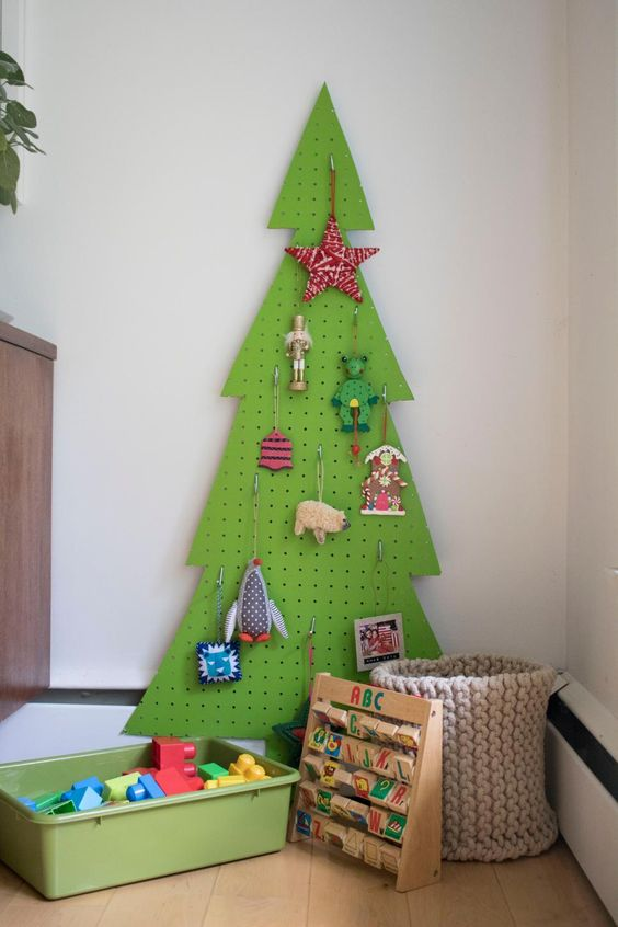 a bright green pegboard Christmas tree is a lovely idea for a kid's room, and your kid may hang toys on that