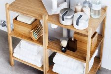 15 two Ragrund shelves by IKEA compose one lightweight sink unit that doesn't look bulky and gives storage space