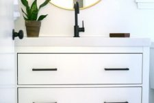 16 an Ikea Hemnes 2-drawer sink cabinet hacked with elegant black handles and a white countertop looks bold and very modern