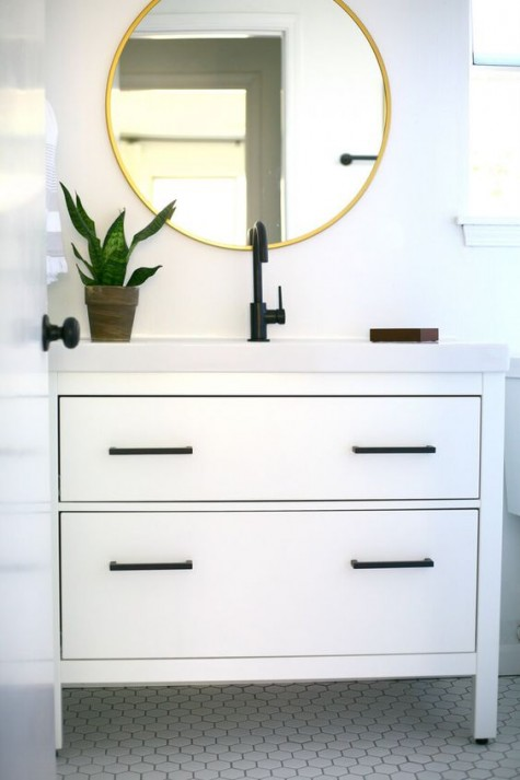 an Ikea Hemnes 2 drawer sink cabinet hacked with elegant black handles and a white countertop looks bold and very modern