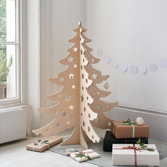 a pretty 3D carved plywood Christmas tree with cut out stars is a cool and ultra-modern idea and you can fold it easily
