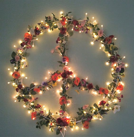 boho floral and light Christmas peace sign wreath is ideal for free-spirited Christmas decor inside and outside