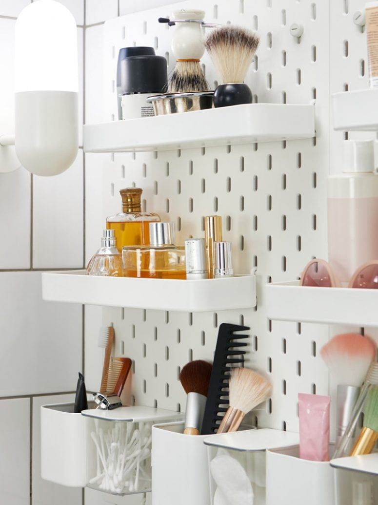 a Skadis pegboard used to store accessories and makeup in a bathroom, this pegboard isn't only for offices, it's for everything