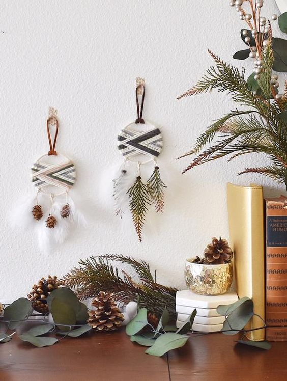 boho tribal Christmas ornaments shaped as dream catchers with feathers, pinecones and fir branches are lovely