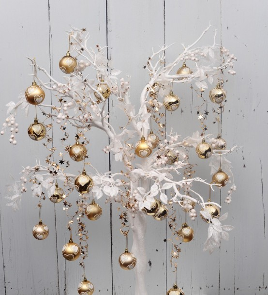 a whimsical white tree with refined gold ornaments is a lovely solution for Christmas celebrating and it will make a statement